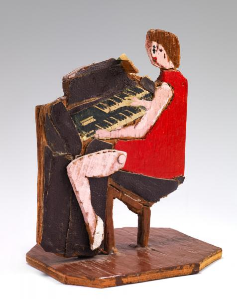 Steve Ashby, Woman in Red Dress at Piano, ca. 1973, carved and painted plywood, found objects, magazine cutouts, Smithsonian American Art Museum, Gift of Chuck and Jan Rosenak and museum purchase through the Luisita L. and Franz H. Denghausen Endowment, 1997.124.49